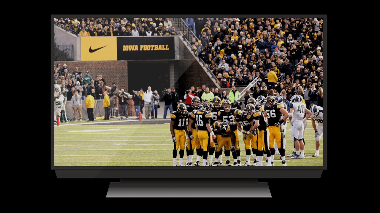 large tv displaying iowa football